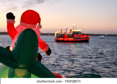 An Inflatable Santa Participates in a Florida Holiday Boat Parade