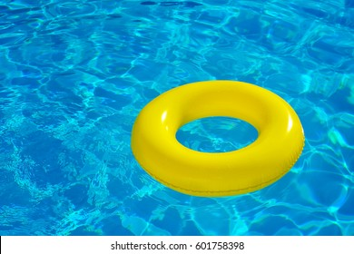 Inflatable tube floating in swimming pool, summer vacation concept