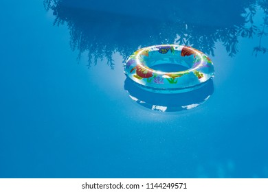 Inflated buoy floating on a swimming pool. Safety and summer concept.