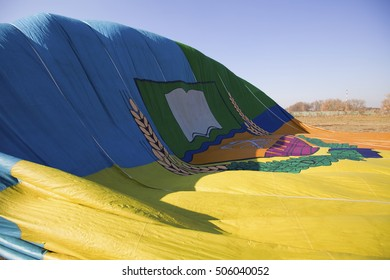 Inflating air balloon on the field