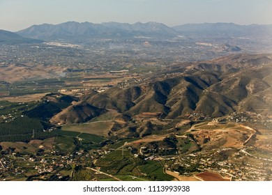Inflight shot of the hills and towns between Malaga airport and the Montes de Malaga, Andalucia, Spain.
