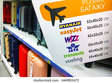 info of cabin baggage allowance of ryanair,easyjet,wizz air,iata,transavia and vueling airlines and luggage on shelfes in a store in Kiev, Ukraine, 11 July 2019.