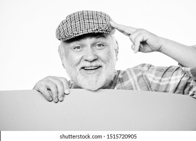 info here. Senior bearded man place announcement on banner. Advertisement shop. wanted. Copy space placate information. job search. Need help. happy mature man in retro hat. Advertisement.
