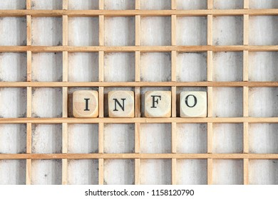 Info sign cubes on a wooden board with dices