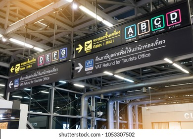 Info sign at Suvarnabhumi International Airport.  Directions for check in, boarding gates, registrations  custom and VAT refund for tourists at terminal connections.