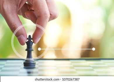 Infographics of Businessman holding a King Chess is placed on a chessboard.using as background business concept and Strategy concept with copy space for your text or design.
