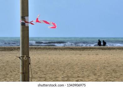 Informal flag along the Versilia shoreline