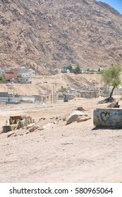 An informal settlement demolished in Aqaba in Jordan with modern houses in the background in the Middle East