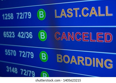 """Information board in airport, arrivals scoreboard with one flight canceled. Illustration for news about flight canceled. """"Last.Call, Canceled, Boarding"""" is written on info board."""