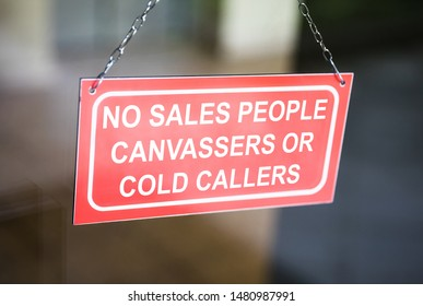 Information Board Of No Salespeople Cold Callers Or Canvassers Sing On A Glass Door