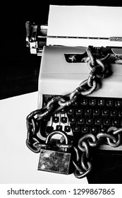 Information censorship concept - Typewriter locked with a chain and padlock - In black and white