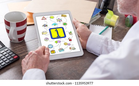 Information concept shown on a tablet held by a man