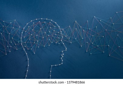 Information flux concept. Network of pins and threads in the shape of a stream of information going through a brain symbolising the hyper connected mind of the digital era.