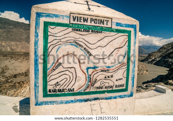 Information map on view point at confluence of rivers Indus and Gilgit in Pakistan, place where three highest mountain ranges of the world meet - Himalayas, Karakoram and Hindukush.