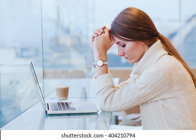 information overload, stress concept, sad desperate woman in front of computer