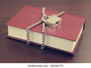 Information security concept, book with chain and padlock