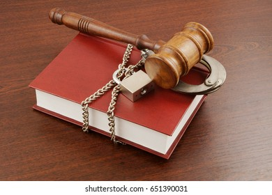 Information security concept, gavel, book with chain and padlock
