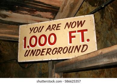 Information sign about depth measurement in underground mine