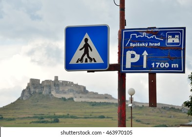 Information sign with the ruins Spissky Hrad castle in the background. Shallow depth of field.