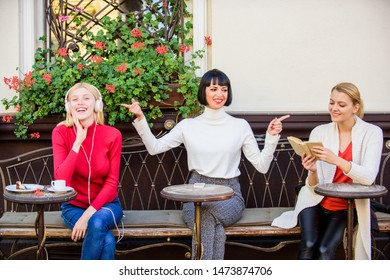Information source. Female leisure. Hobby and leisure. Different interests. Weekend relax and leisure. Group pretty women cafe terrace entertain themselves with reading speaking and listening.