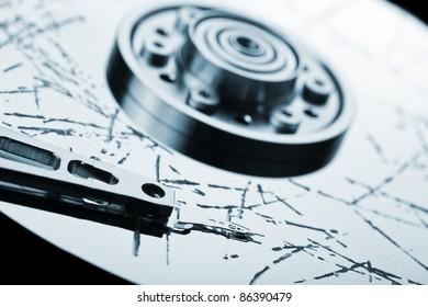 Information storage data loss concept - broken computer technology hard disk drive surface