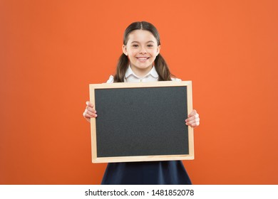 Informing kids changes in school life. School girl pupil hold blackboard copy space. School news concept. Check out responsibilities of pupils. Topic of todays lesson. School schedule information.
