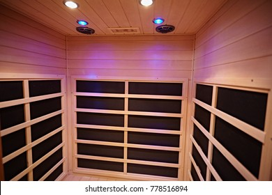 Infrared cabin in the sauna with wood trim