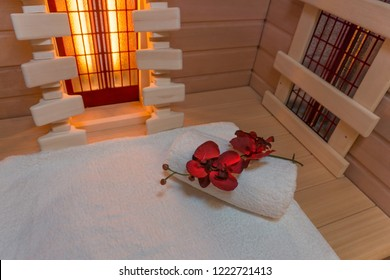 Infrared cabin with a white towel and a beautiful flower