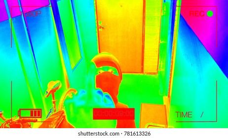infrared hidden camera night vision recorded as the robber in a mask running off with a bag of loot,shows the camera the middle finger.