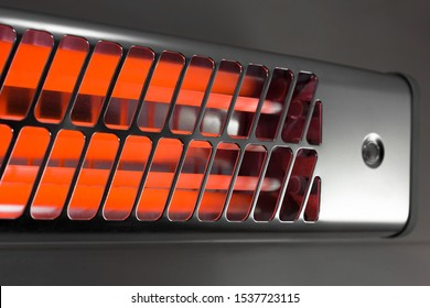 Infrared light electric heater on a bathroom wall – for cold winter days