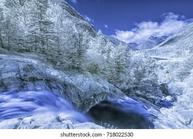 Infrared long exposure photography: waterfall within Aiguestortes National Park, Vall de Boi, Lleida, Catalunya, Spain
