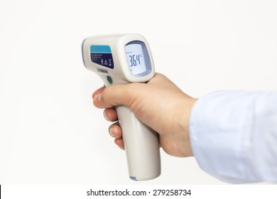 Infrared medical thermometer in hand