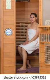Infrared sauna cabin with thai woman inside