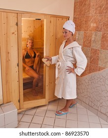 A infrared sauna cabin with two sexy womans