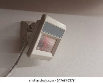 Infrared sensors detect movement on a white wall.