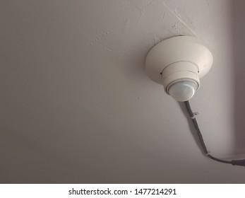 Infrared sensors detect movement on a white plaster ceiling.