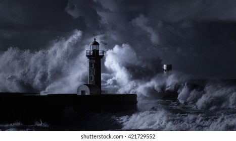 Infrared stormy seascape with huge waves against Douro river mouth old lighthouse, Porto, north Portugal.