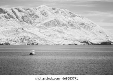 Infrared view of boat in Kotor bay