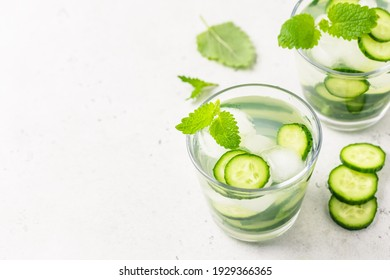 Infused cucumber iced water. Space for text, top view.