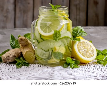 Infused detox water with cucumber, lemon, ginger and mint for diet healthy eating and weight loss with copy space. Selective focus