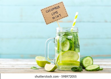 infused detox water with cucumber, lime and mint for diet healthy eating and weight loss with space for a text