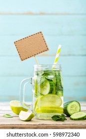 infused detox water with cucumber, lime and mint for diet healthy eating and weight loss with blank space for your text