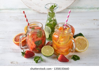 Infused fruit detox water on a wooden background