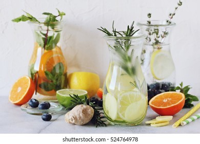 Infused water with citrus fruits and ginger.Detox beverages in glass jar and ingredients. Selective focus