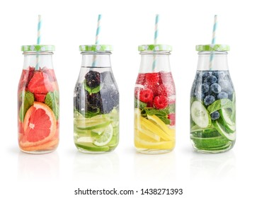 Infused water with fresh fruits, vegetables and berry in bottles isolated on white background