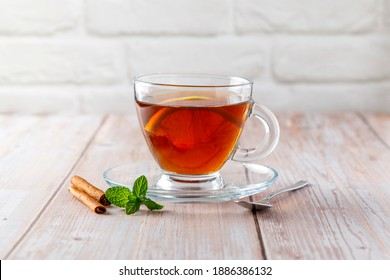 Infusion of hot tea with lemon and cinnamon