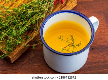 Infusion of thyme. Ingredient of Mediterranean cuisine and healing home remedy. Home remedy healing, disinfectant, relieves breathing problems, with anti-aging flavonoids, for indigestion, strengthens