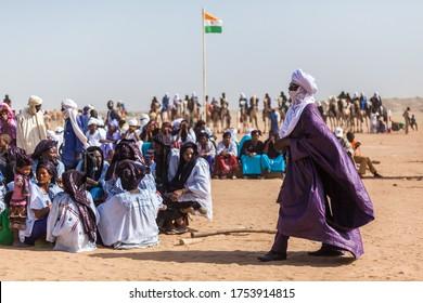 Ingall, Niger - September 2013: Nomad people at sahara desert festival