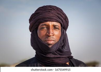 Ingall, Niger - september 2013: Tuareg man in traditional turban close up