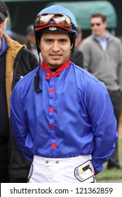 """INGLEWOOD, CA - DEC 8: Mario Gutierrez , who rode """"I'll Have Another"""" to victory in 2 legs of the Triple Crown, waits for his mount in the paddock at Hollywood Park on Dec 8, 2012 in Inglewood, CA."""